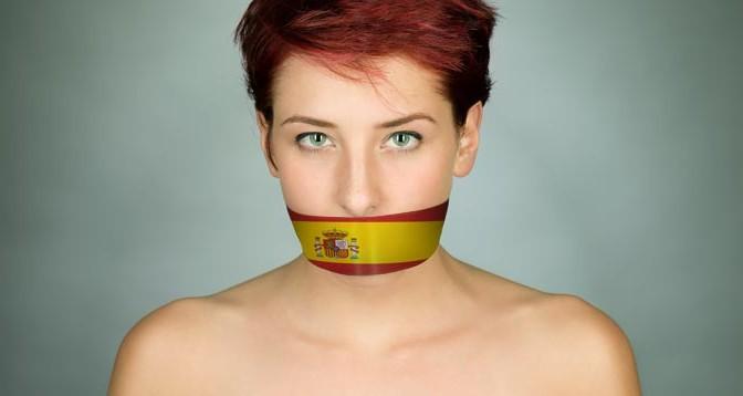 Mujer-Ley-Mordaza-Bandera-Espana-Acracia
